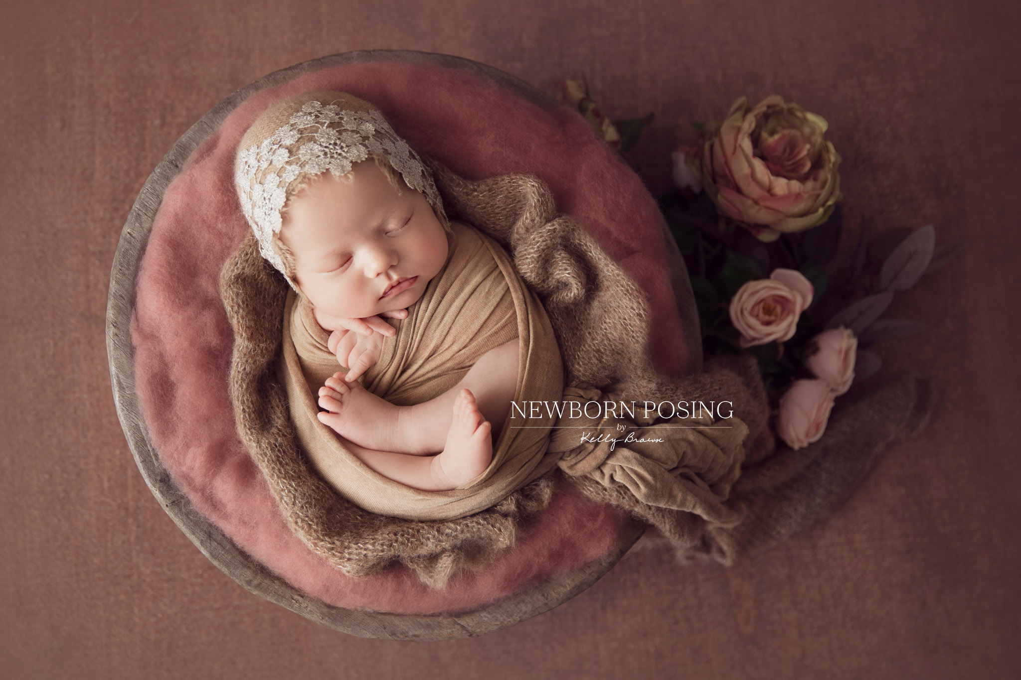 Newborn photography of a baby in a prop wrapped