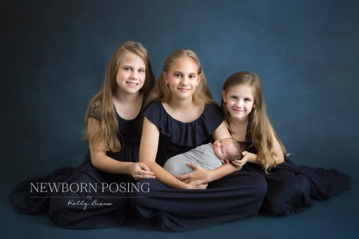 Newborn photography of siblings hold the baby